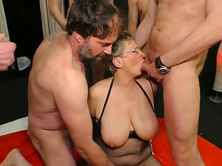 Big tittied cougar Grace is fucked hard by four young and insatiable dudes