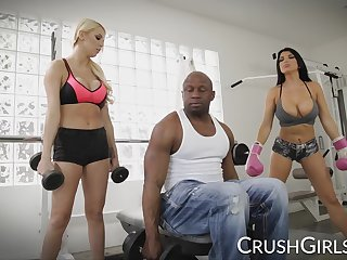Kenzie and Romi share a fat black cock vanguard gym