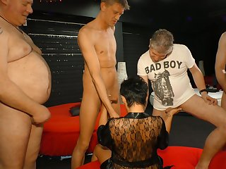 Aged experienced prostitute is fucked hard wits several kinky dudes