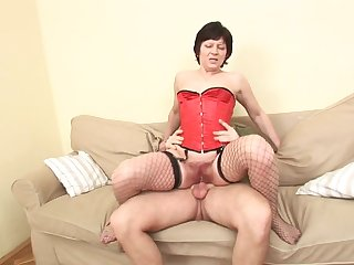 Old whore in a sexy corset bounces on his dick