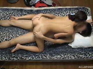 Amateur Japanese angel rides the dick connected with charm