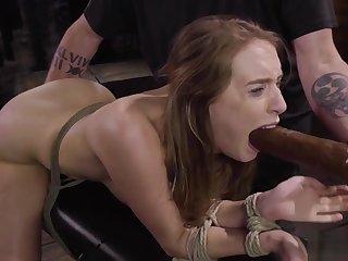 Hogtied brunette gagged with dildo
