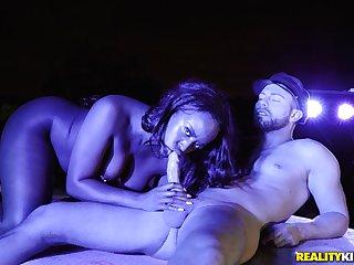 Ebony deals heavy white cock during hot midnight shag