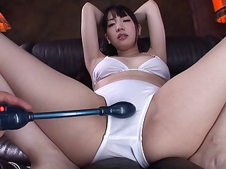 Japanese pornstar squirts after getting her pussy stroked with a vibrator