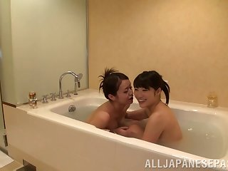 Salacious lesbian girls make out erotically forwards bath till they ascent