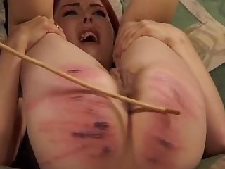 Skinny slut moans and cries while a dirty dominant lady spanks her