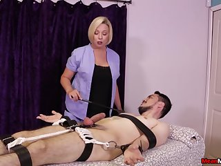 Strict peaches masseuse gives a Femdom handjob to a bound client
