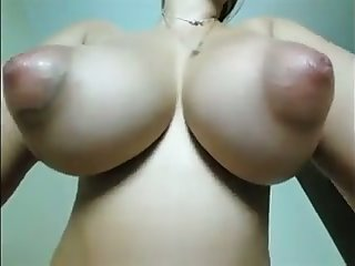 Incredibly giant boobies with huge nipples are flashed by amateur cam girl