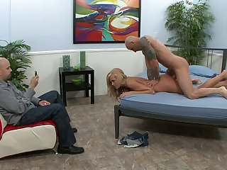 Handsome blonde wife Darcy Taylor fucked more than the bed by a stranger