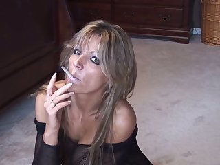 This mature woman's solo smoking session is stunning and I love her big Bristols