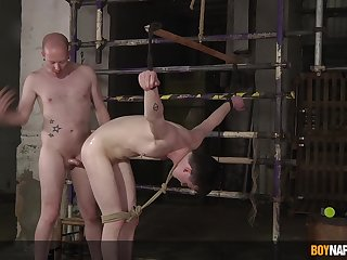 Severe anal bondage of the submissive twink