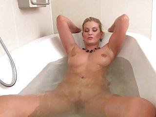 Naughty unaccompanied blonde Samantha Snow enjoys playing almost the bath-tub