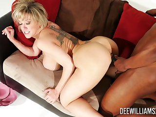 Marvelous doggy sex on the Davenport for a premium mature with big jugs
