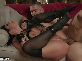 Aroused brunette screams and undulates while being fucked handcuffed