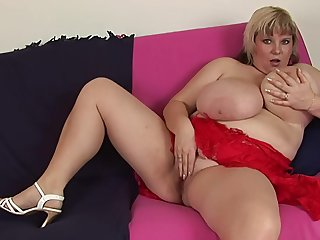 Chubby slattern Juliana B. moans while playing at hand a red lady-love toy