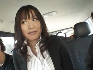 Enticing Japanese chick Kasumi Uemura gives a BJ in back of the jalopy